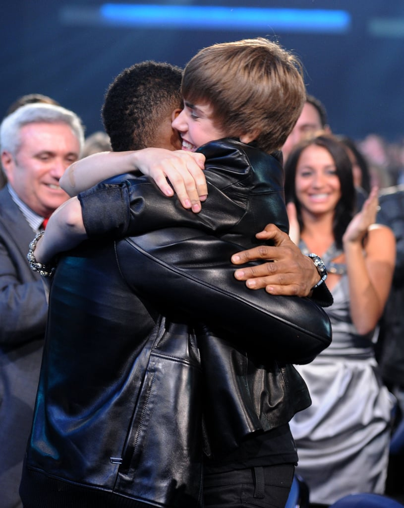 A young Justin Bieber got a hug from Usher at the AMAs in November 2010.