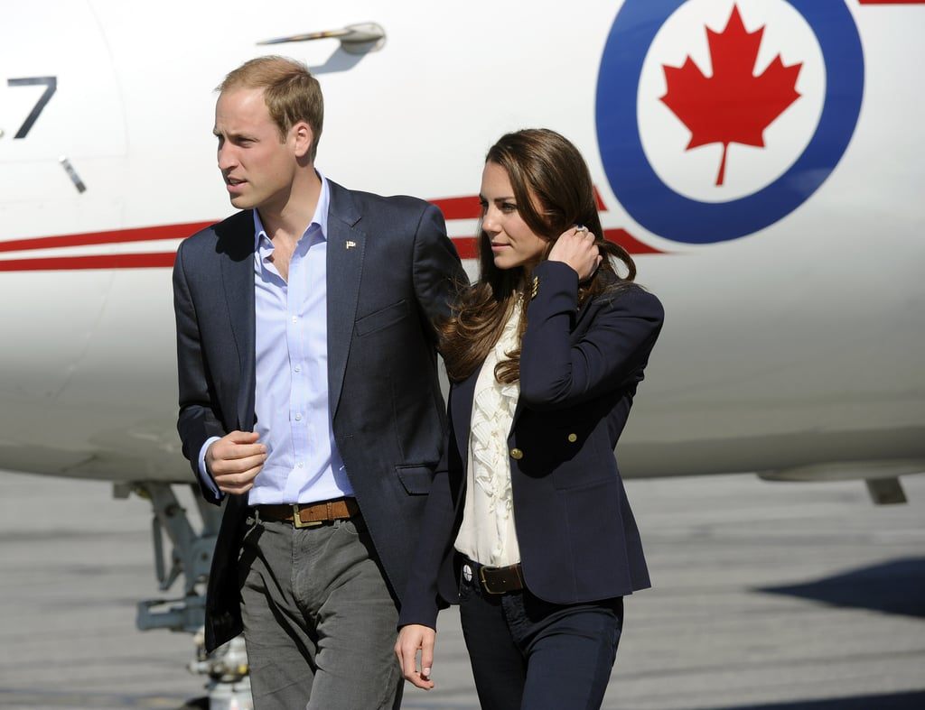 The Duke and Duchess of Cambridge landed at an airport in Yellowknife, Northwest Territories, today. Prince William and Kate Middleton were both dressed casually in navy blazers, and Kate wore jeans for their latest stop. It's been a busy week for the couple, who arrived in Canada at the beginning of the month and have been on the go with public appearances and events ever since. William and Kate went canoeing on Blachford Lake yesterday after trying their hand at street hockey earlier in the day. Their visit north is wrapping up on Friday, and the royal duo are headed to California, where they're expected to attend a BAFTA party, but you can check out all the pictures of Kate Middleton and Prince William's Canada tour before the duo arrive on the West Coast.
