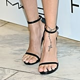 One of Nicole's first tattoos was an anklet design with a cross on her left foot.
