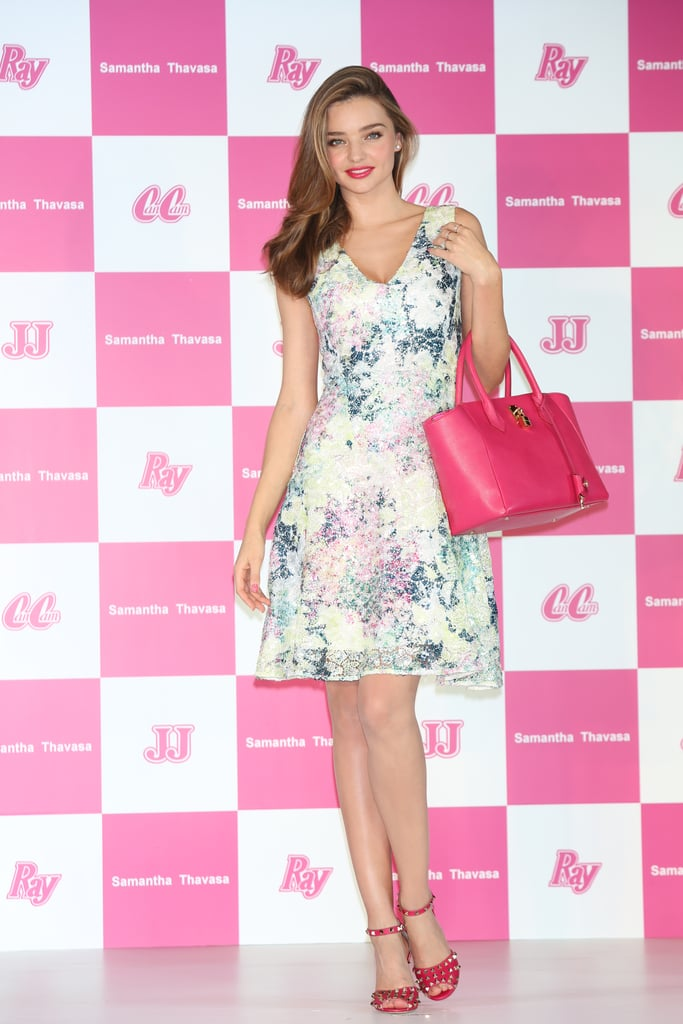 Hot-pink accents added extra eye appeal to Miranda Kerr's flirty dress at a Samantha Thavasa event in Japan.