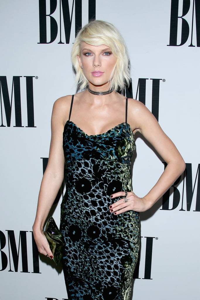 """Another day, another flawless appearance by Taylor Swift. On Tuesday, the """"Bad Blood"""" singer popped up at the BMI Pop Awards in Beverly Hills, where she received the first-ever Taylor Swift award for her influence in the music world. Clad in a sexy low-cut dress complete with a choker, the star did not disappoint as she continued to rock her new sexy, edgy look, which we most recently caught a glimpse of at the Met Gala earlier this month. Keep reading to see more of Taylor's night out, and then check out the epic dance-off between her and Tom Hiddleston you didn't see at the Met Gala."""