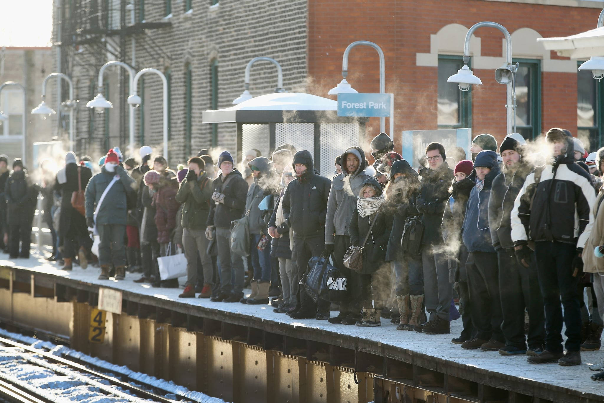 Chicagoans braved the cold to wait for the train in subzero temperatures.