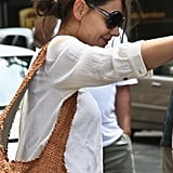 Katie Holmes had her hair pulled back in a low bun.
