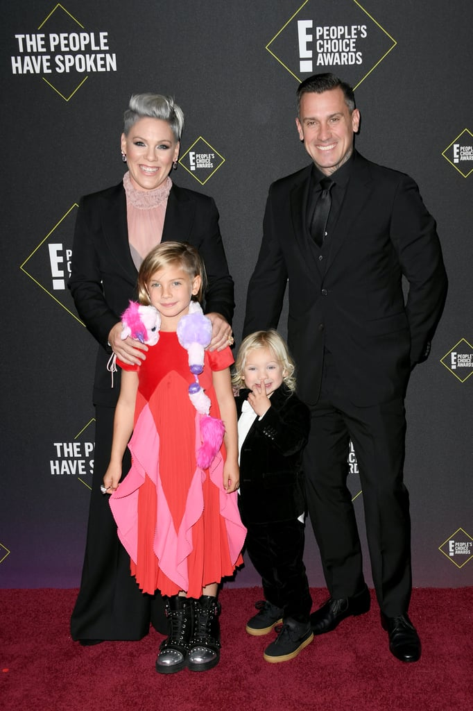 Pink was surrounded by loved ones as she attended the 2019 People's Choice Awards on Sunday night. The singer, who received the People's Champion award during the show, walked the red carpet with her longtime husband Carey Hart and their adorable kids, 8-year-old daughter Willow and 2-year-old son Jameson. The family of four was all smiles as they held hands and posed for the cameras. As much as we're obsessed with Pink and Carey's adorable romance, we have to give it up to their children for stealing the spotlight. They're just so cute! Keep reading for even more pictures from Pink's big night ahead.