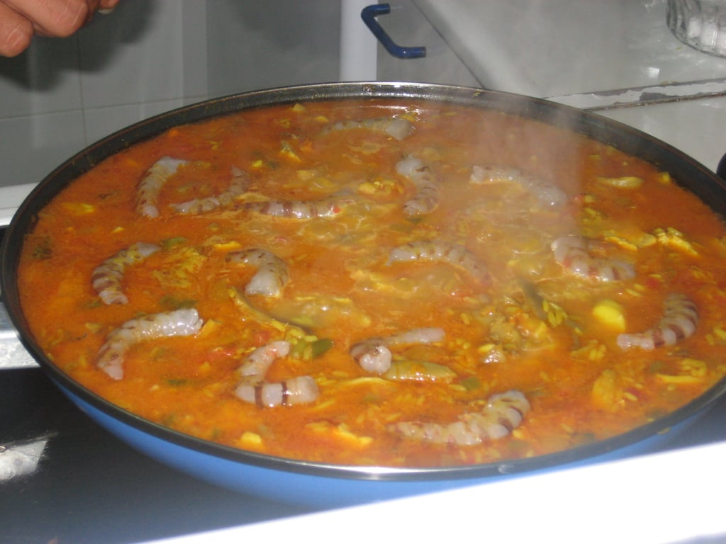 The quick-cooking shrimp are the last ingredient to be added to the paella.  Stir into the rice to ensure that the shrimp pick up all of the flavors.