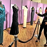 Host of Fashion Television Jeanne Beker snaps pictures of the dresses.