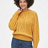 If she's not afraid to go bold with her color palette, this mustard yellow Marbled Cable-Knit Crewneck Sweater ($80) will be a great addition to her wardrobe.