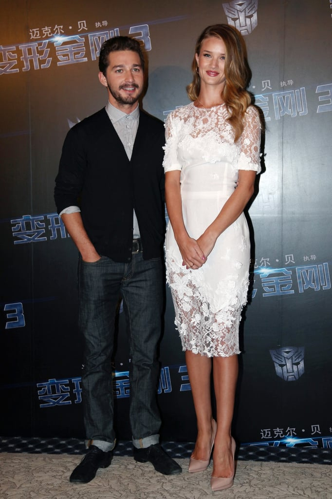 Shia LaBeouf and Rosie Huntington-Whiteley posed at a photocall for Transformers: Dark of the Moon at the Waldorf Astoria in Shanghai today. Rosie wore a gorgeous white Dolce & Gabbana dress and Christian Louboutin heels for the event, which director Michael Bay also attended. Costars Shia and Rosie have been on the go promoting the film since its huge opening earlier this month just before July 4. The action film continued to rake in the earnings at the box office during its second weekend out in the States. Shia and Rosie premiered Transformers in NYC late last month after making appearances in Russia and Germany. Shia has taken some time out, though, to hang with girlfriend Karolyn Pho while Rosie has likewise shared a few dates with her significant other, Jason Statham.