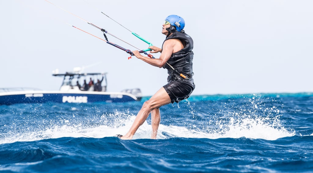 Here he is kitesurfing like it's nobody's business (check out those leg muscles!).