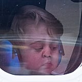 Prince George looked pretty upset about leaving as he smushed his face up against the plane window.