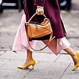 If your look is particularly pink, ground it a little with a tailored coat in a deep shade of burgundy.