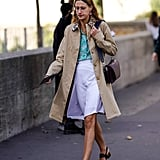 Pair your embellished sandals with a trench coat, printed top, and white skirt.