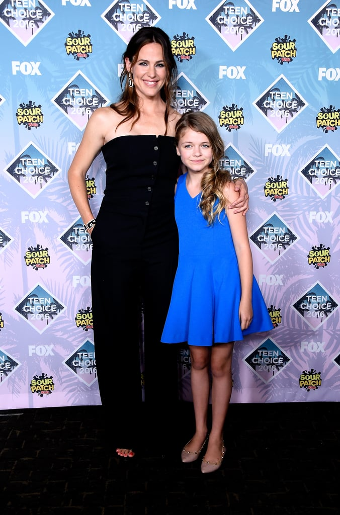 """Jennifer Garner lit up the Teen Choice Awards in LA on Sunday when she took the stage with her Miracles From Heaven costar Kylie Rogers to accept the choice drama movie award for their film, which also stars Queen Latifah. The ladies thanked the voters for their giant surfboard and posed for photos together backstage; Jennifer looked fresh and gorgeous in a black strapless jumpsuit and half-up hairstyle — anyone else getting 13 Going on 30 vibes? We've seen a lot of Jen lately, both on the red carpet and on the streets of LA. Most recently, she looked carefree while running errands amid reports that she and estranged husband Ben Affleck aren't planning to divorce after all — a friend close to the actress revealed to People that """"Ben still doesn't want the divorce and he might actually get his way."""" She also stepped out for the Starkey Hearing Foundation Gala earlier this month, where she was honored for her work with early education."""