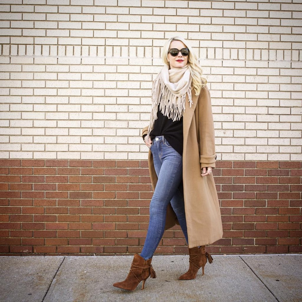 With a Black Shirt, Brown Booties, and a Fringe Scarf