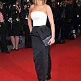 What better way to step out at the Cannes Film Festival than in a sleek black-and-white outfit by Christian Dior — accessorized with a sparkling box clutch, of course.