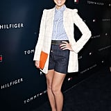 Olivia Munn was decked out in head-to-toe Tommy Hilfiger, wearing crisp denim shorts, a striped blouse, a white blazer, and platform loafers.
