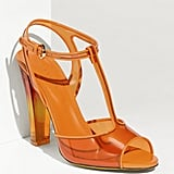 A pop of orange PVC lends a bright edge. Sergio Rossi T-Strap Sandal ($795)