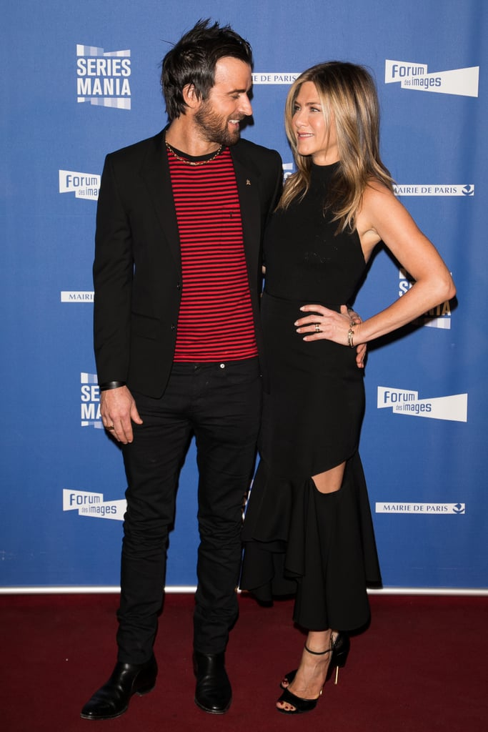 Jennifer Aniston and Justin Theroux stayed by each other's side at the opening night of Series Mania Festival in Paris on Thursday. After showing off their love at a Louis Vuitton event earlier in the week, the two hit the red carpet once more for a photocall at the Le Grand Rex theater. The two looked quite cuddly for the cameras as they held hands, locked eyes, and wrapped their arms around each other. Jen looked stunning in a black Givenchy dress with a slit, while Justin rocked a striped red tee, black blazer, and matching jeans. Needless to say, these two make one good-looking pair!      Related:                                                                                                           The Way They Were: A Look Back at Jennifer Aniston and Justin Theroux's Sweetest Moments