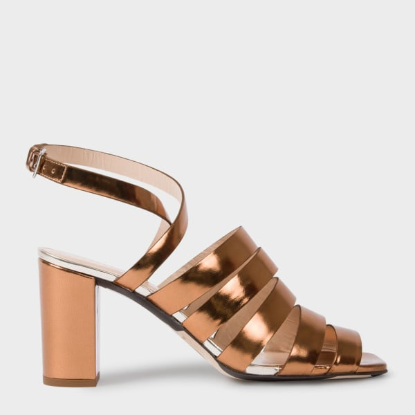 Paul Smith Metallic Bronze Leather 'Asa' Heeled Sandals ($450) will add the few inches you need to see your favorite artists performing at festivals.