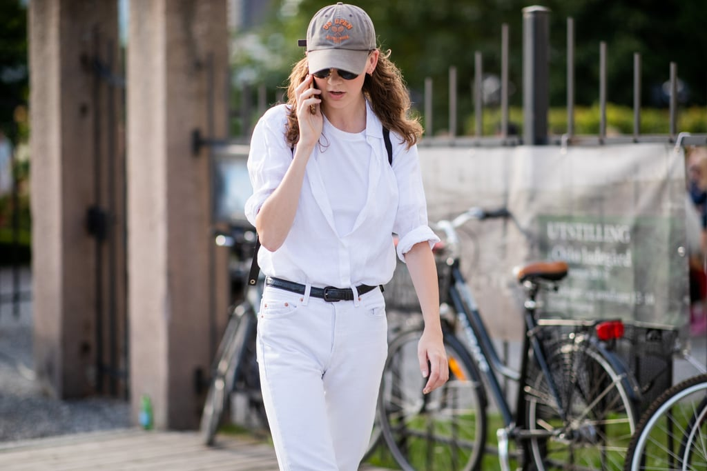 Layer a button-down over your standard tee and roll up the sleeves. Accent your separates with a dark leather belt.