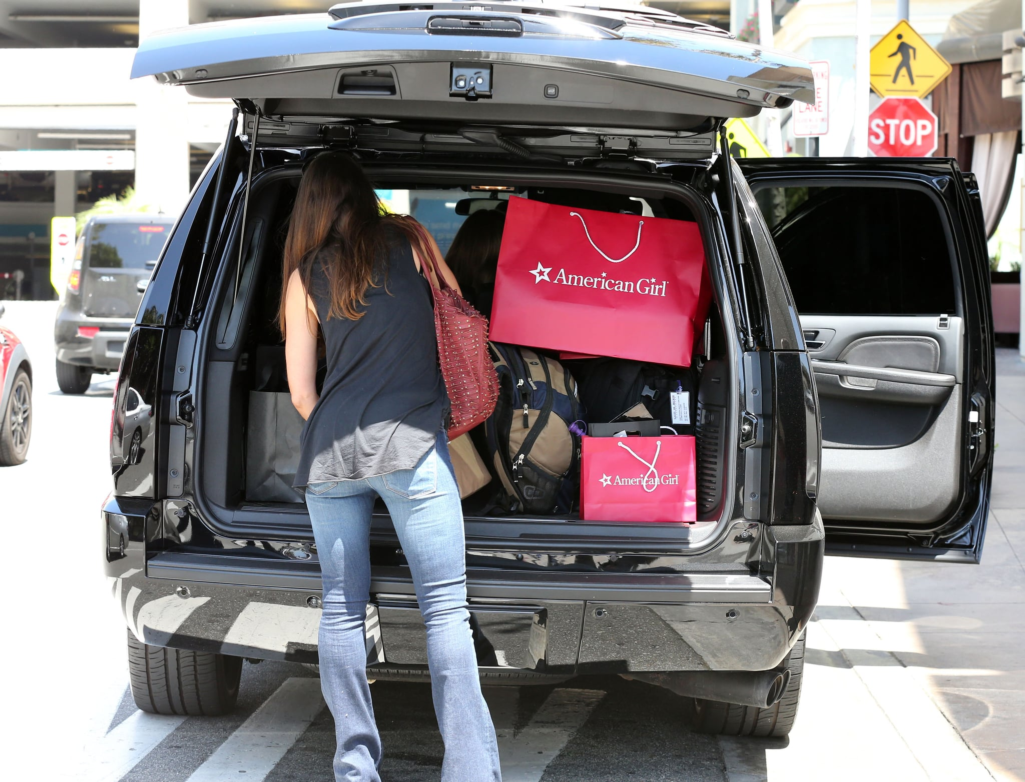 Victoria Beckham packed her car in LA after a Memorial Day shopping trip.