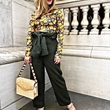 One of the best features of a boilersuit is the versatility, so I got creative and styled mine like pants on my second go — I did this by folding the suit down and tying the sleeves around my waist. Willing Spring my way but staying warm, I mixed in a thin floral print turtleneck, structured straw bag, and crystal-adorned mules in pink suede (I also wore the cutest gold mobile earrings, but alas, my hair took center stage). While this look is far outside my comfort zone, the feminine twist felt fresh, comfortable, and super fun for Spring.  On Laura: POPSUGAR at Kohl's utility suit, Maje turtleneck, Jimmy Choo mules, Pamela Munson bag, Zoë Chicco earrings.