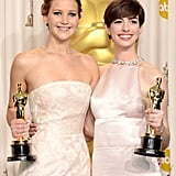 Jennifer Lawrence and Anne Hathaway at the Oscars 2013.