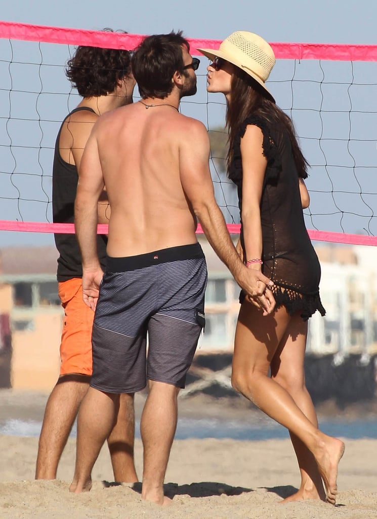 Alessandra Ambrosio and Jamie Mazur traded kisses during a July 2012 beach day in Malibu, CA.