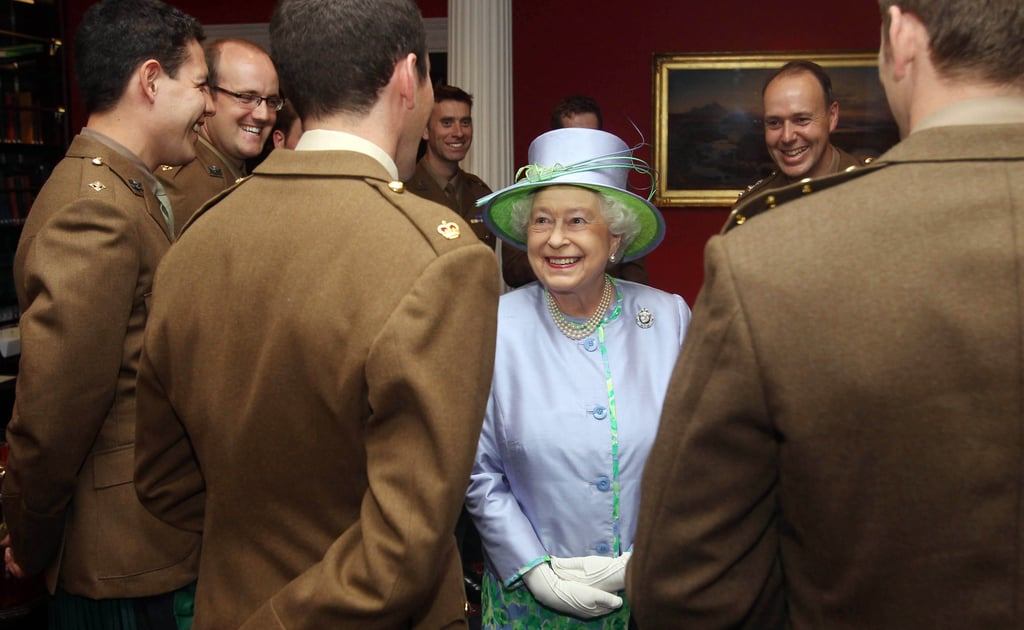 Queen Elizabeth laughs with the Argyll and Sutherland Highlanders, 5th Battalion the Royal Regiment of Scotland.