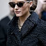 Olivia Palermo gave us the poshest of show-going styles with cat-eye glasses and a gorgeous coat.
