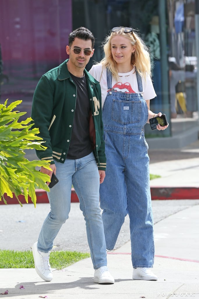 Joe Jonas and Sophie Turner are enjoying some quality time together after a few busy months. The couple, who are reportedly expecting their first child together, stepped out for a smoothie run in LA on Friday. Joe dressed casual in jeans and a letterman jacket, while Sophie covered up in a cute pair of jean overalls. The two looked calm and relaxed as they held hands and chatted on the sidewalk.  The appearance comes about a week after the Jonas Brothers wrapped their Happiness Begins Tour. After traveling all over the world, the band is taking a well-deserved break before they head out to Las Vegas for their first residency. And they don't plan on stopping there! Following their residency in April, the brothers plan on releasing their sixth album. Plus, Sophie is getting to premiere her new Quibi thriller series Survive in April. Hopefully Joe and Sophie can get some R & R before the arrival of their first child, who is expected this Summer. See more pictures from their latest outing ahead.       Related:                                                                                                           It's Clear That Joe Jonas and Sophie Turner Make Each Other Incredibly Happy