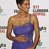 Halle Berry cradled her baby bump at the premiere of The Call in Argentina.