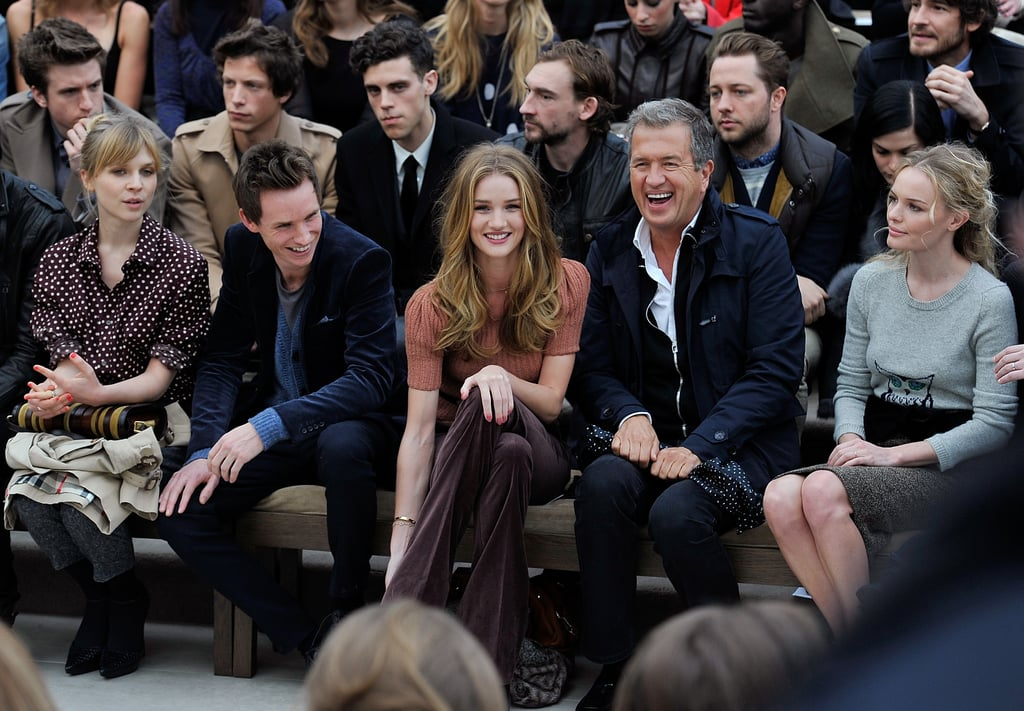 Eddie Redmayne, Rosie Huntington-Whiteley, Mario Testino, and Kate Bosworth laughing at the Fall 2012 Burberry Fashion show.