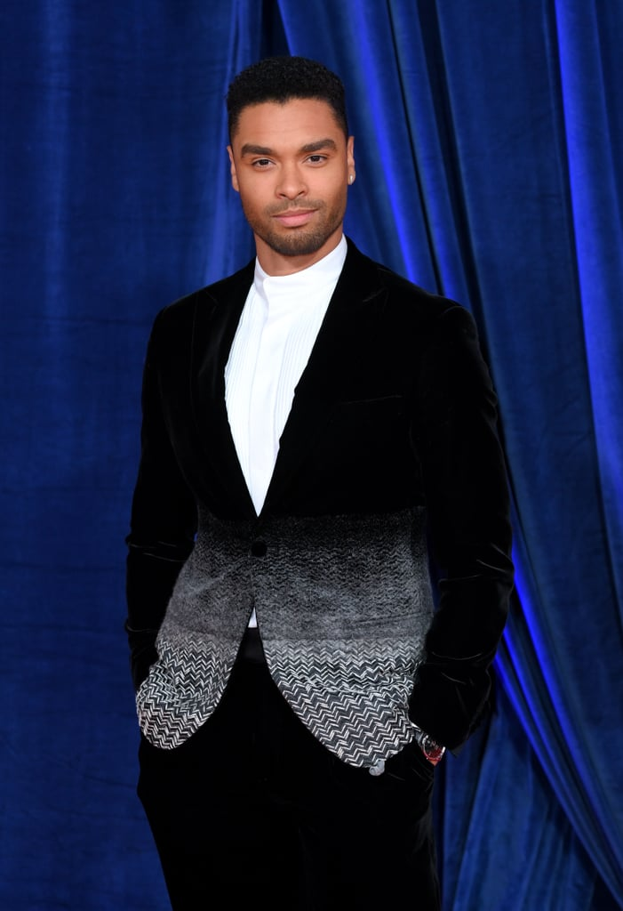 We're willing to bet the red carpet at the Harder They Fall premiere in London was at least 10 degrees hotter after Regé-Jean Page stepped out looking like the modern-day Duke of Hastings. Dressed to the nines for the debut of the new Netflix western, Regé-Jean arrived in a canvas and velvet Giorgio Armani tuxedo jacket from the SoHo collection. The jacket, layered over a pleated white button-up, was drawn together by a single black velvet button at the base of a deep V-neckline, and we've never envied an accessory so much.  Looking dapper from every angle, the former Bridgerton star gave us a glimpse at the jacket's intricate white chevron pattern from every angle, drawing attention to the ombré effect of the stitching around his waist. Keeping the look simple and classy, Regé-Jean opted not to wear a tie for the event and instead paired the outfit with a silver watch and black oxford shoes. In other words, we will be adding his red carpet photos to our modern-day fairy-tale dream boards. Admire his look from all angles here.       Related:                                                                                                           Cardi B Understood Every Single Assignment During Paris Fashion Week