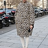A leopard-print car coat popped against stark white tights and neutral heels.