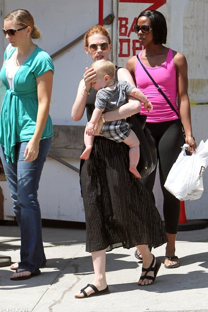 January Jones shielded Xander from the sun while in LA.
