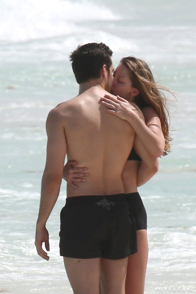 Supergirl star Melissa Benoist has been living it up in Cancun, Mexico with her new boyfriend (and costar) Chris Wood. On Sunday, the couple popped up at the beach and looked relaxed and happy while taking a stroll through the town. Later that week, they hit ocean together, sharing a laugh and making out in the waves. The couple's beach vacation comes just a couple weeks after they took their romance public; they was spotted walking each other's dogs in Vancouver and a source confirmed to ET that they were dating. Melissa announced her divorce from Glee costar Blake Jenner in December after two years of marriage, and Chris recently split from girlfriend Hanna Mangan Lawrence.