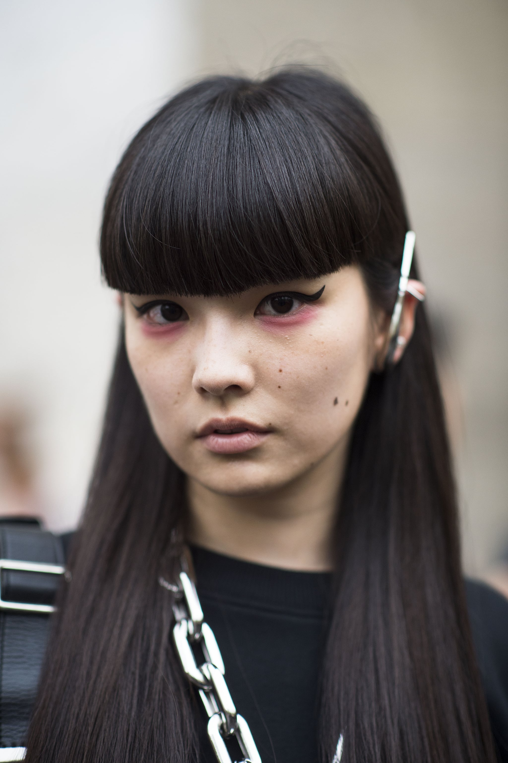 This blunt bangs/pink shadow/cat-eye liner combination is one of the coolest we've seen all month.  Source: Le 21ème | Adam Katz Sinding