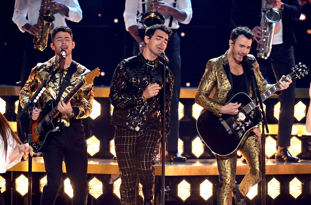 "The Jonas Brothers hit the Grammys stage for the first time in over a decade on Sunday night. The brothers, who are up for best pop duo/group performance, sang a new track, titled ""5 More Minutes,"" before performing ""What a Man Gotta Do."" During a Shazam video, the brothers revealed that the songs would be part of a ""forthcoming album."" Did you hear that? Another Jonas Brothers album is in the works! Kevin, Joe, and Nick looked in their element as they rocked out on stage in gold outfits. Naturally, they had the support of their respective wives, aka the ""J Sisters,"" as they cheered them on in the crowd. Kevin even leaned to kiss Danielle while making his way to the main stage with his brothers. The last time the brothers attended the Grammys together was all the way back in 2010 before their breakup in 2013. Clearly a lot has changed since then. After announcing their reunion last year, the brothers have released a documentary, dropped a new album, and gone on tour. With the release of their songs and the recent announcement of their Las Vegas residency, it seems like they don't plan on slowing down anytime soon."