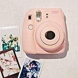 """For the thrifty friend who loves vintage shopping, give her the gift of instant memories the old fashion way.""   Polaroid Camera  ($87)"