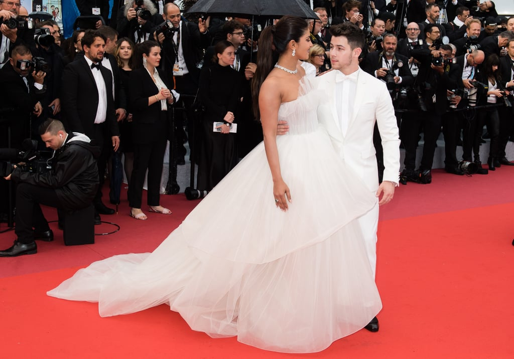 "Nick Jonas and Priyanka Chopra are smitten with each other at the Cannes Film Festival in France. On Friday, the two were spotted getting close and cuddly at the event as they walked around hand in hand. Priyanka — who was there to promote the documentary 5B — stunned in a a blue silk maxi dress and white hat, and Nick looked dapper in an all-white suit. Later, they hit up the Chopard party, where they gazed into each other's eyes on the red carpet as Priyanka rocked a purple dress and Nick sported a tuxedo. And as the festival continued, they made even more cute arrivals at parties and formal gatherings.   It's been an exciting month for the couple. They kicked off May with a special appearance at the Billboard Music Awards, where Nick performed with his brothers and gave Priyanka a kiss during the set. Shortly after, they attended the Met Gala together, where their kooky outfits gave us adorable Alice in Wonderland and Game of Thrones vibes. When it comes to red carpets and event appearances, they reign supreme.  View more photos of them enjoying the Cannes Film Festival ahead!      Related:                                                                                                           Priyanka Chopra Admits She ""Judged a Book by Its Cover"" When She First Met Nick Jonas"