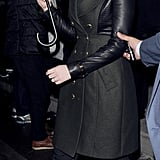 Jennifer Lawrence braved the London chill in a leather-sleeved military coat, black cropped jeans, and sparkly pumps.