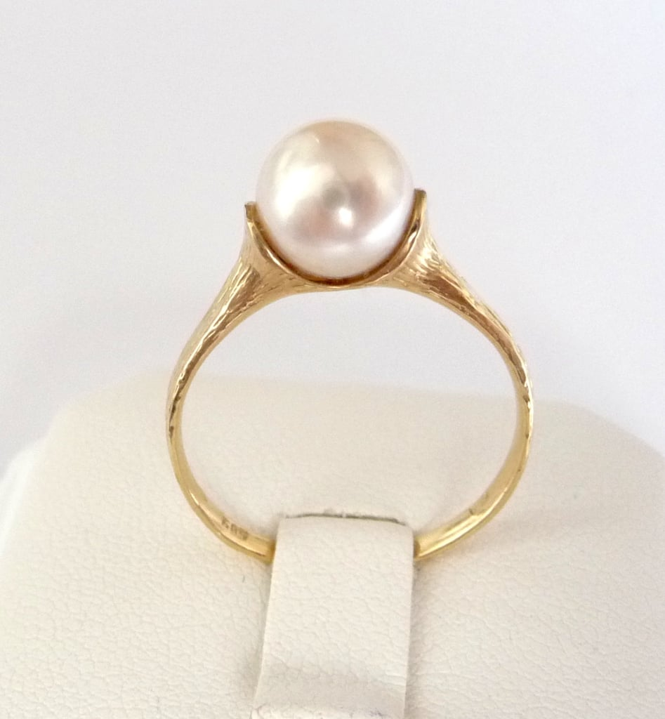 This handmade gold pearl engagement ring ($275) was crafted from 14k recycled yellow gold with a 8mm white round pearl.