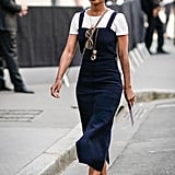 Keep it classic and easy with a white tee and navy mid-length dress on top.