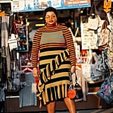 A striped top is a bold base layer to multicolored slip dress.