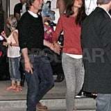 Tom Cruise and Katie Holmes hold hands.