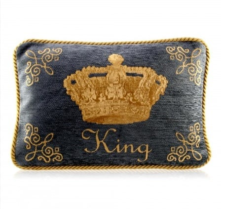 A posh embroidered pillow ($69) pays homage to the little king in-waiting.