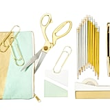 "Metallic Accent Pencil Pouch ($9); 9.5"" Gold Handle Scissors ($17); 10-Count Metallic Foil Wrapped Pencils ($5); 4-Count Gold Oversized Paper Clips ($3); Sticky Notes ($5); Gold Dipped Stapler ($16)"