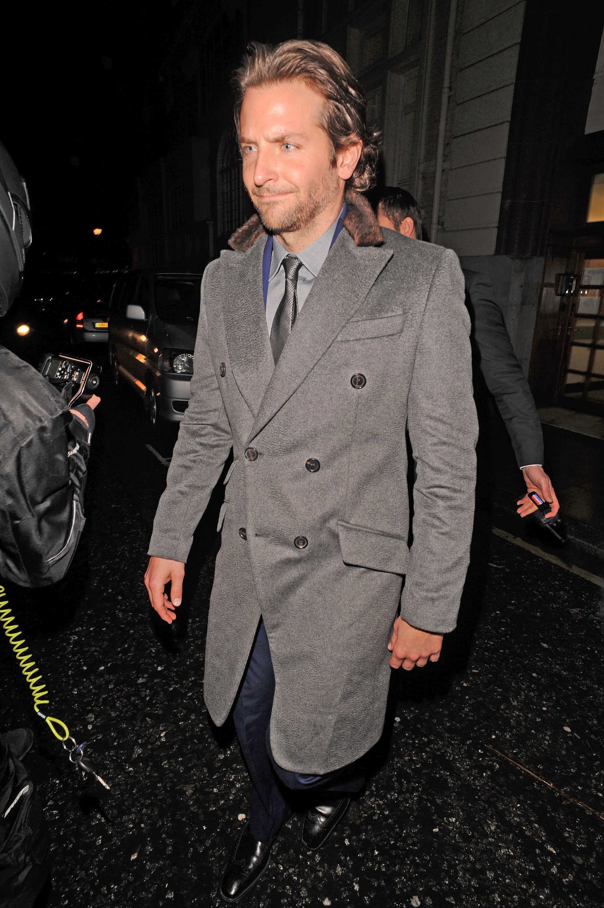 Bradley Cooper sported a coat and tie.