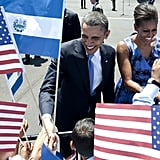 The Obamas seemed eager to greet young school children upon arrival on Air Force One in San Salvador, El Salvador.